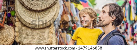 BANNER, LONG FORMAT Boy at a market in Ubud, Bali. Typical souvenir shop selling souvenirs and handi Stock photo © galitskaya