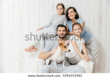 Photo of cheerful woman embraces dog with love, spend free time together, expresses tender feeling a Stock photo © vkstudio