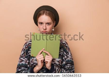 фото недовольный женщину дневнике глядя Сток-фото © deandrobot