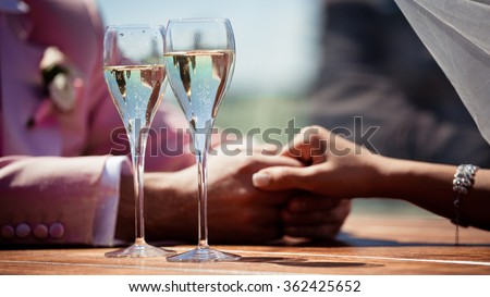 Stock photo: Closeup of couple drinking champagne and looking into each others' eyes