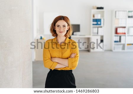 Confident businesswoman with folded arms smiling at the camera against a white background stock photo © wavebreak_media