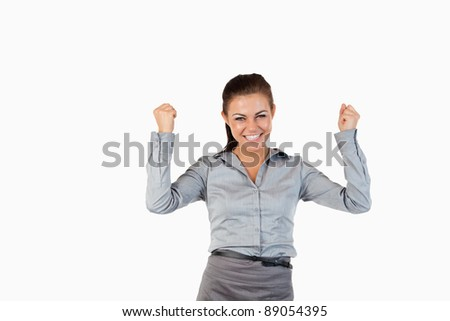Happy businesswoman with the fists up against a white background Stock photo © wavebreak_media