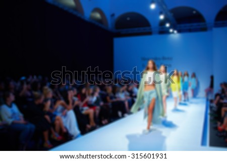Runway Fashion Model walking on Podium in Black Trendy Garments. Elegance Stock photo © gromovataya