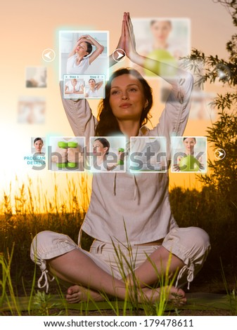 Stockfoto: Sporty Woman Outdoors Working Out Using Modern Virtual Interface