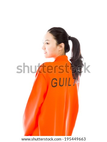 side profile of an asian young woman smiling in prisoners uniform stock photo © bmonteny