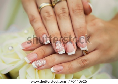 Wedding manicured nail. Bride woman french nails.Bridal ring. De Stock photo © Victoria_Andreas