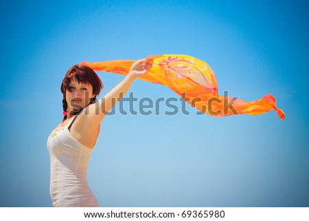 Enjoyment. Happy free woman jumping over sea and blue sky, brune Stock photo © Victoria_Andreas