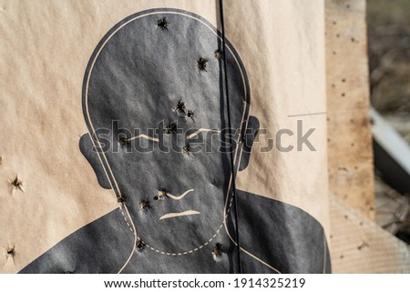Target for shooting practice in man silhouette shape with marks on head and body stock photo © Evgeny89