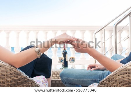 Close up, couple in love sitting on a mountain, hugging and look stock photo © Yatsenko