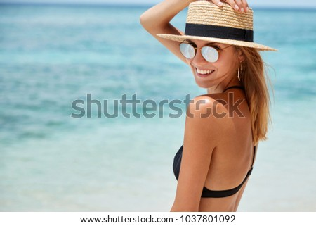 Beautoful adult female with straw hat posing on mediterranean st Stock photo © stevanovicigor