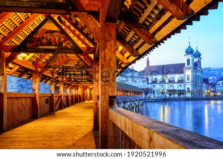 View through historical Chapel Bridge to the old town of Lucerne, Switzerland Stock photo © Xantana