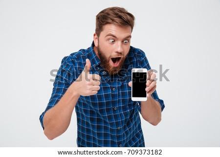 tevreden · bebaarde · man · shirt · smartphone - stockfoto © deandrobot