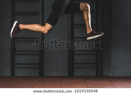 Cropped image of a muscular young sportsman doing cardio exercises Stock photo © deandrobot