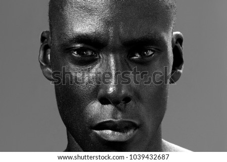 Close-up photo of serious young afro american guy with stylish h Stock photo © deandrobot