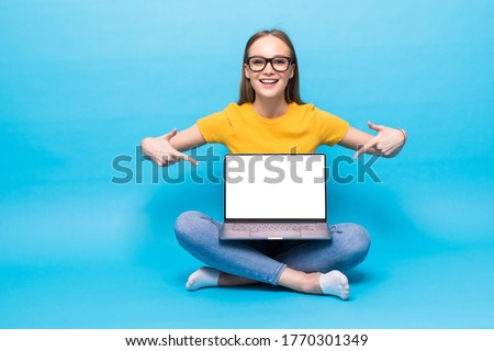 attractive female with beautiful smile holding silver notebook g stock photo © deandrobot