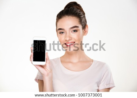 Portrait of smiling content woman demonstrating efficient cell p Stock photo © deandrobot