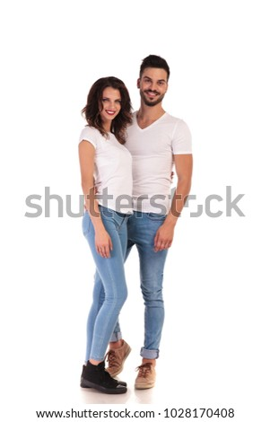 Full-length picture of happy woman in jeans and sneakers holding Stock photo © deandrobot
