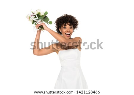 brunette bride in white dress throwing wedding bouquet, isolated on white Stock photo © LightFieldStudios