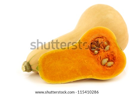 bottle shaped butternut pumpkin and a cut one on a white backgro Stock photo © ungpaoman