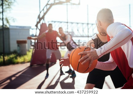 image of caucasian and american men playing basketball at the pl stock photo © deandrobot
