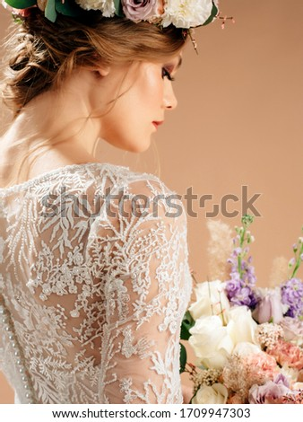 Bridesmaid portrait in studio. Attractive young woman with perfect make-up and hair style Stock photo © artfotodima