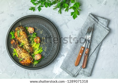 Chicken drumstick in a black ceramic plate with orange and rosem Stock photo © artsvitlyna