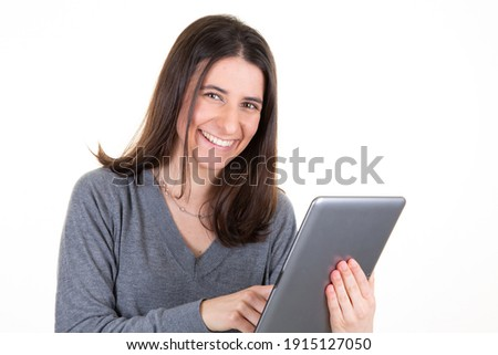 image of caucasian woman 20s smiling and holding silver laptop stock photo © deandrobot