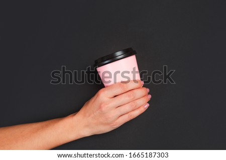 image of beautiful woman holding takeaway coffee in paper cup an stock photo © deandrobot