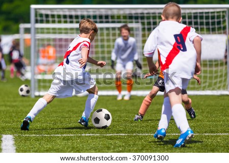 Junior Soccer Match. Football Game For Youth Players. Boys Playi stock photo © matimix