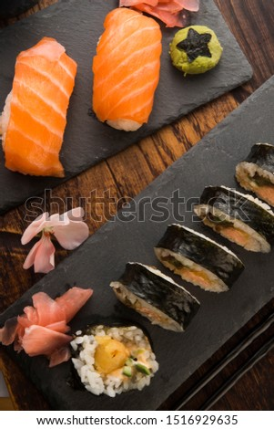 A plate of different combination of sushi with a bowl of soba Stock photo © joannawnuk