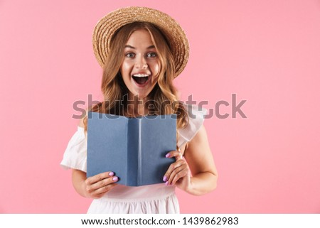 shocked happy young woman posing isolated over pink wall background holding cotton disk stock photo © deandrobot