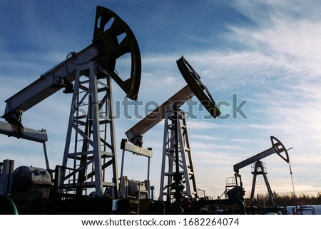 Energy Resources: Oil And Gas Rigs, extraction, fractional distillation, and storage tanks. Stock photo © Glasaigh