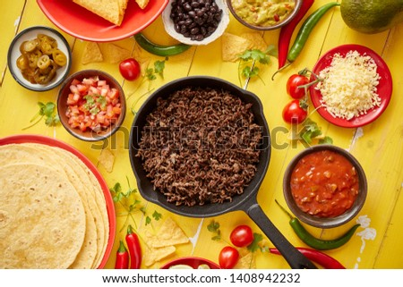 Various fresh and tasty ingredients for chilli con carne. With meat on iron pan Stock photo © dash