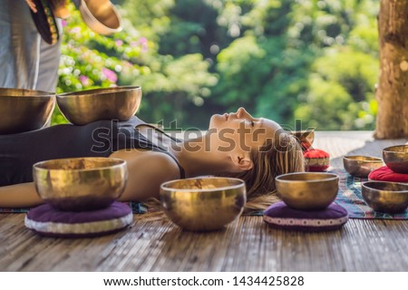 Woman relaxing with singing bowl Stock photo © Kzenon