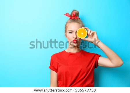 Portrait of beautiful woman in bright clothing and bow in head w Stock photo © dashapetrenko
