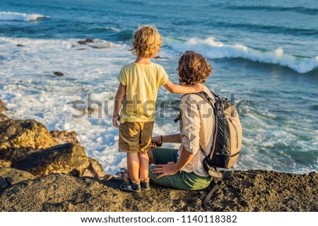 Father and son are walking along the cosmic Bali beach.. Portrait travel tourists - dad with kids. P Stock photo © galitskaya