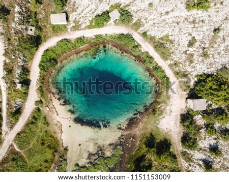 Cetina river source water hole and Orthodox church aerial view Stock photo © xbrchx