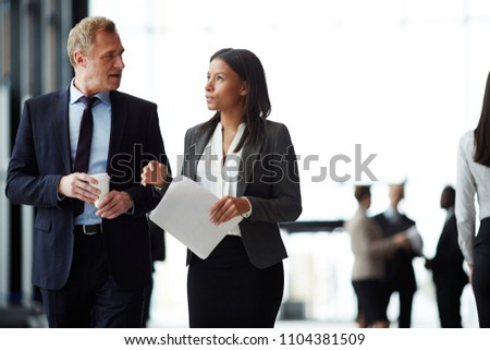 Young intercultural colleagues in formalwear working individually Stock photo © pressmaster