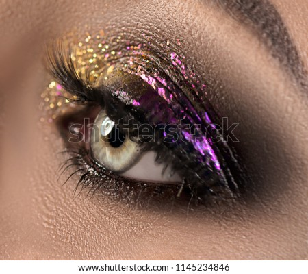 eye makeup beautiful eyes glitter make up holiday makeup detail stock photo © serdechny