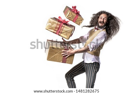 Conceptual portrait of a colorful man running with a bunch of gi Stock photo © majdansky