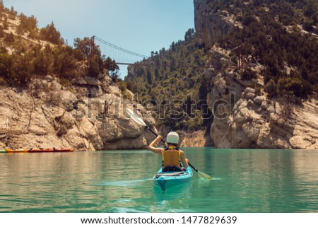 woman in kayak on a river crossing a gorge in the pyrenees mountains stock photo © kzenon