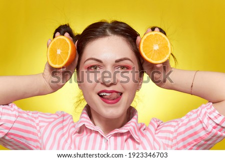 Smiling girl with fresh fruits. Beauty model takes juicy oranges. Joyful girl with freckles. The con Stock photo © serdechny