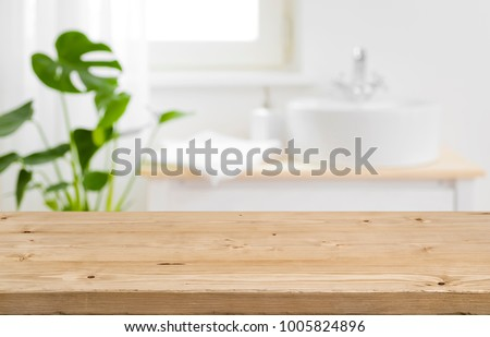 Towels on wooden table with copy space on blurred bathroom backg stock photo © ijeab