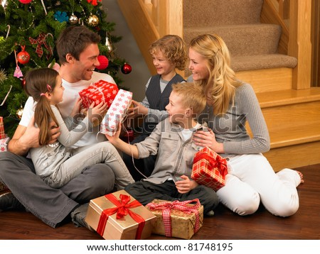 Happy family celebrates Christmas. Mom, Dad and Son in Christmas Decorations stock photo © galitskaya