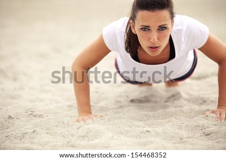 woman push-up exercise workout fitness doing outside on grass  i Stock photo © Freedomz