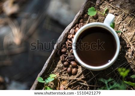Kubek kawy fotele ziemi żelaza Zdjęcia stock © butenkow