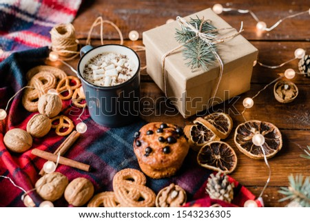 Giftbox surrounded by drink, cinnamon sticks, walnuts, lemon slices and cookies Stock photo © pressmaster