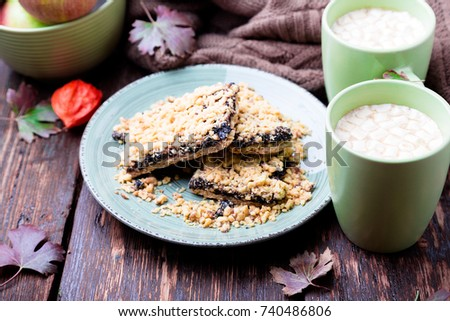 Two cup of coffee or hot chocolate with marshmallow near knitted blanket and pie. Autumn concept. Ch Stock photo © Illia