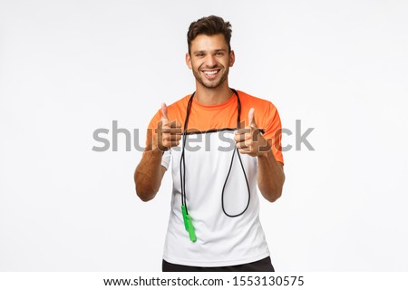 Man praise client efforts, showing thumbs-up supportive in approval or like, wrap skipping rope arou Stock photo © benzoix
