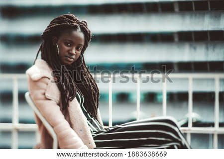 Part of face of young woman with dreadlocks and white headphones Stock photo © pressmaster